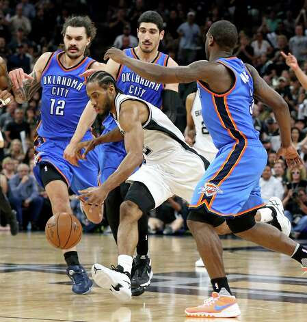 San Antonio Spurs' Kawhi Leonard looks for room between Oklahoma City Thunder's Steven Adams, Enes Kanter, and Dion Waiters during second half action of Game 5 in the Western Conference semifinals Tuesday May 10, 2016 at the AT&T Center. The Thunder won 95-91. Photo: Edward A. Ornelas, Staff / San Antonio Express-News / © 2016 San Antonio Express-News