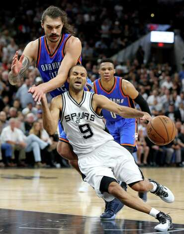 San Antonio Spurs' Tony Parker is fouled by Oklahoma City Thunder's Steven Adams during second half action of Game 5 in the Western Conference semifinals Tuesday May 10, 2016 at the AT&T Center. The Thunder won 95-91. Photo: Edward A. Ornelas, Staff / San Antonio Express-News / © 2016 San Antonio Express-News