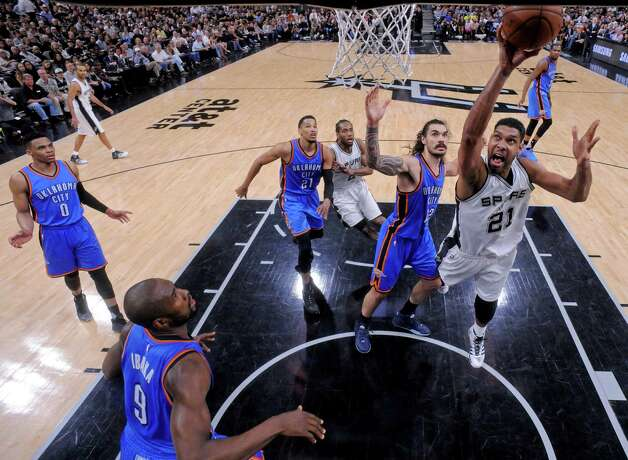 San Antonio Spurs' Tim Duncan shoots around Oklahoma City Thunder's Steven Adams as Russell Westbrook (from left), Serge Ibaka, Andre Roberson, and San Antonio Spurs' Kawhi Leonard look on during Game 5 in the Western Conference semifinals Tuesday May 10, 2016 at the AT&T Center. The Thunder won 95-91. Photo: Edward A. Ornelas, Staff / San Antonio Express-News / © 2016 San Antonio Express-News