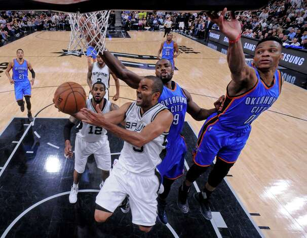 San Antonio Spurs' Tony Parker shoots around Oklahoma City Thunder's Serge Ibaka (left) and Russell Westbrook during Game 5 in the Western Conference semifinals Tuesday May 10, 2016 at the AT&T Center. The Thunder won 95-91. Photo: Edward A. Ornelas, Staff / San Antonio Express-News / © 2016 San Antonio Express-News