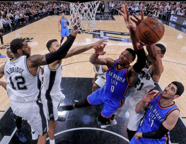 Oklahoma City Thunder's Russell Westbrook shoots between San Antonio Spurs' LaMarcus Aldridge, Kyle Anderson, and Tim Duncan, as Oklahoma City Thunder's Enes Kanter looks on during Game 5 in the Western Conference semifinals Tuesday May 10, 2016 at the AT&T Center. The Thunder won 95-91. Photo: Edward A. Ornelas, Staff / San Antonio Express-News / © 2016 San Antonio Express-News