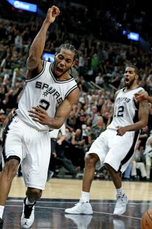 San Antonio Spurs' Kawhi Leonard reacts after a dunk over Oklahoma City Thunder's Russell Westbrook during second half action of Game 5 in the Western Conference semifinals Tuesday May 10, 2016 at the AT&T Center. The Thunder won 95-91. Photo: Edward A. Ornelas, Staff / San Antonio Express-News / © 2016 San Antonio Express-News