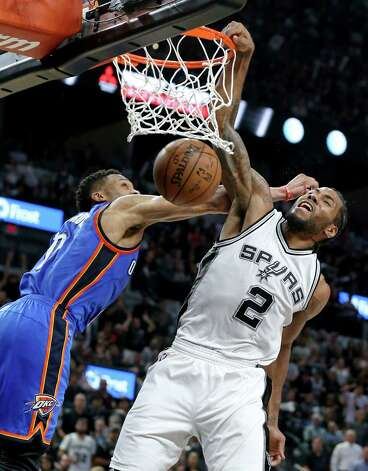 San Antonio Spurs' Kawhi Leonard dunks over Oklahoma City Thunder's Russell Westbrook during second half action of Game 5 in the Western Conference semifinals Tuesday May 10, 2016 at the AT&T Center. The Thunder won 95-91. Photo: Edward A. Ornelas, Staff / San Antonio Express-News / © 2016 San Antonio Express-News