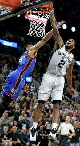 San Antonio Spurs' Kawhi Leonard goes up for a dunk over Oklahoma City Thunder's Russell Westbrook during second half action of Game 5 in the Western Conference semifinals Tuesday May 10, 2016 at the AT&T Center. The Thunder won 95-91. Photo: Edward A. Ornelas, Staff / San Antonio Express-News / © 2016 San Antonio Express-News