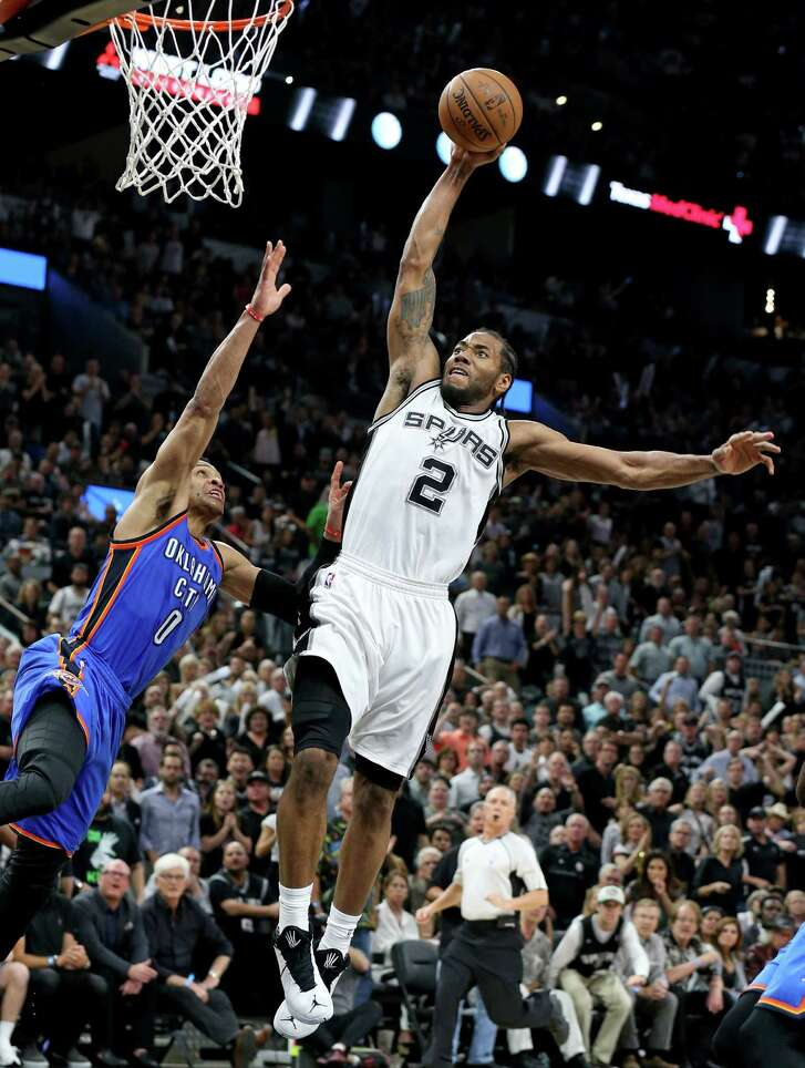 San Antonio Spurs' Kawhi Leonard goes up for a dunk over Oklahoma City Thunder's Russell Westbrook during second half action of Game 5 in the Western Conference semifinals Tuesday May 10, 2016 at the AT&T Center. The Thunder won 95-91.