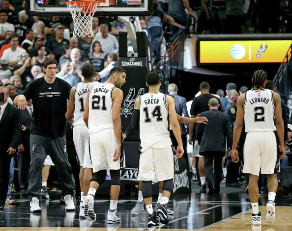 San Antonio Spurs' LaMarcus Aldridge, Tim Duncan, and Danny Green, and Kawhi Leonard walk off the court after Game 5 in the Western Conference semifinals against the Oklahoma City Thunder Tuesday May 10, 2016 at the AT&T Center. The Thunder won 95-91. Photo: Edward A. Ornelas, Staff / San Antonio Express-News / © 2016 San Antonio Express-News