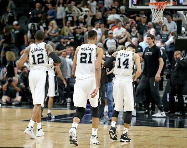 San Antonio Spurs' LaMarcus Aldridge, Tim Duncan, and Danny Green walk off the court after Game 5 in the Western Conference semifinals against the Oklahoma City Thunder Tuesday May 10, 2016 at the AT&T Center. The Thunder won 95-91. Photo: Edward A. Ornelas, Staff / San Antonio Express-News / © 2016 San Antonio Express-News