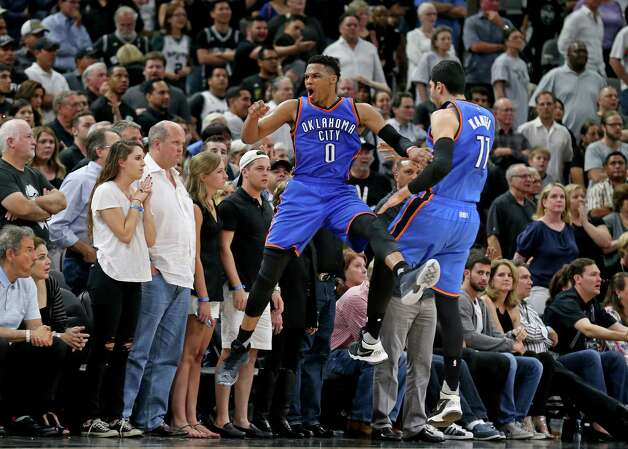 Oklahoma City Thunder's Russell Westbrook celebrates with teammate Enes Kanter after a basket late in second half action of Game 5 in the Western Conference semifinals against the San Antonio Spurs Tuesday May 10, 2016 at the AT&T Center. The Thunder won 95-91. Photo: Edward A. Ornelas, Staff / San Antonio Express-News / © 2016 San Antonio Express-News