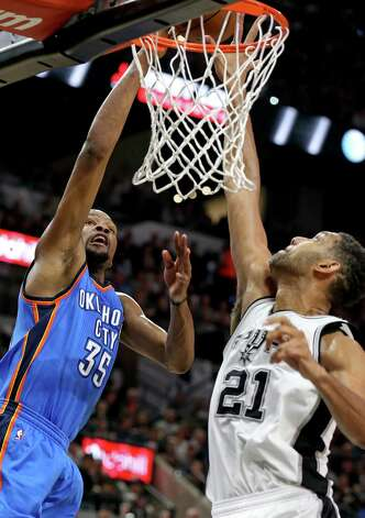 Oklahoma City Thunder's Kevin Durant shoots against San Antonio Spurs' Tim Duncan during first half action of Game 5 in the Western Conference semifinals Tuesday May 10, 2016 at the AT&T Center. Photo: Edward A. Ornelas, Staff / San Antonio Express-News / © 2016 San Antonio Express-News