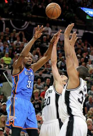 Oklahoma City Thunder's Kevin Durant passes over San Antonio Spurs' Manu Ginobili and Boris Diaw during first half action of Game 5 in the Western Conference semifinals Tuesday May 10, 2016 at the AT&T Center. Photo: Edward A. Ornelas, Staff / San Antonio Express-News / © 2016 San Antonio Express-News