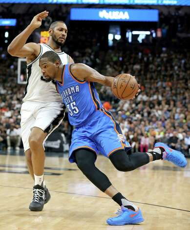 San Antonio Spurs' Boris Diaw defends Oklahoma City Thunder's Kevin Durant during first half action of Game 5 in the Western Conference semifinals Tuesday May 10, 2016 at the AT&T Center. Photo: Edward A. Ornelas, Staff / San Antonio Express-News / © 2016 San Antonio Express-News