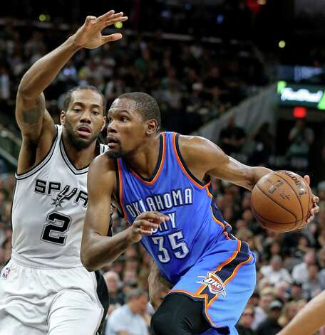 San Antonio Spurs' Kawhi Leonard defends Oklahoma City Thunder's Kevin Durant during first half action of Game 5 in the Western Conference semifinals Tuesday May 10, 2016 at the AT&T Center. Photo: Edward A. Ornelas, Staff / San Antonio Express-News / © 2016 San Antonio Express-News