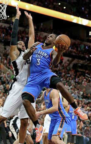 San Antonio Spurs' LaMarcus Aldridge defends Oklahoma City Thunder's Dion Waiters during first half action of Game 5 in the Western Conference semifinals Tuesday May 10, 2016 at the AT&T Center. Photo: Edward A. Ornelas, Staff / San Antonio Express-News / © 2016 San Antonio Express-News