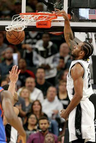 San Antonio Spurs' Kawhi Leonard dunks during first half action of Game 5 in the Western Conference semifinals against the Oklahoma City Thunder Tuesday May 10, 2016 at the AT&T Center. Photo: Edward A. Ornelas, Staff / San Antonio Express-News / © 2016 San Antonio Express-News