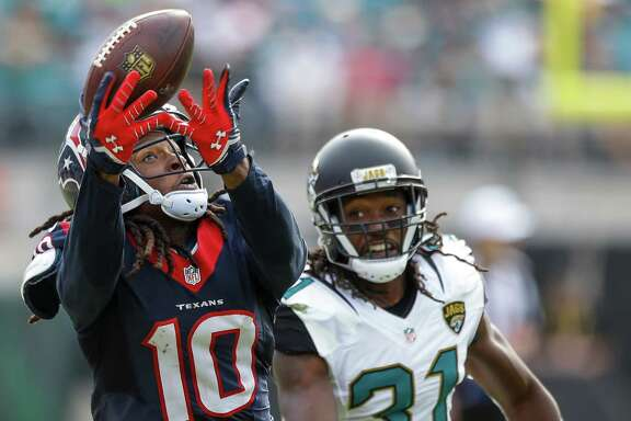 Houston Texans wide receiver DeAndre Hopkins (10) beats Jacksonville Jaguars cornerback Davon House (31) for a reception down the sidelines during the fourth quarter of an NFL football game at EverBank Field on Sunday, Oct. 18, 2015, in Jacksonville. ( Brett Coomer / Houston Chronicle )