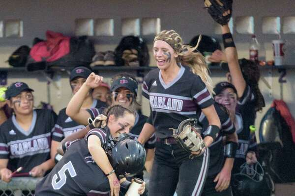 Lindsey Stewart (5) of the Pearland Lady Oilers celebrates with her teammates after scoring the first run in the second inning against the Deer Park Lady Deer in the Regional Quarterfinals on Friday, May 13, 2016 at the Dawson High School ballpark.