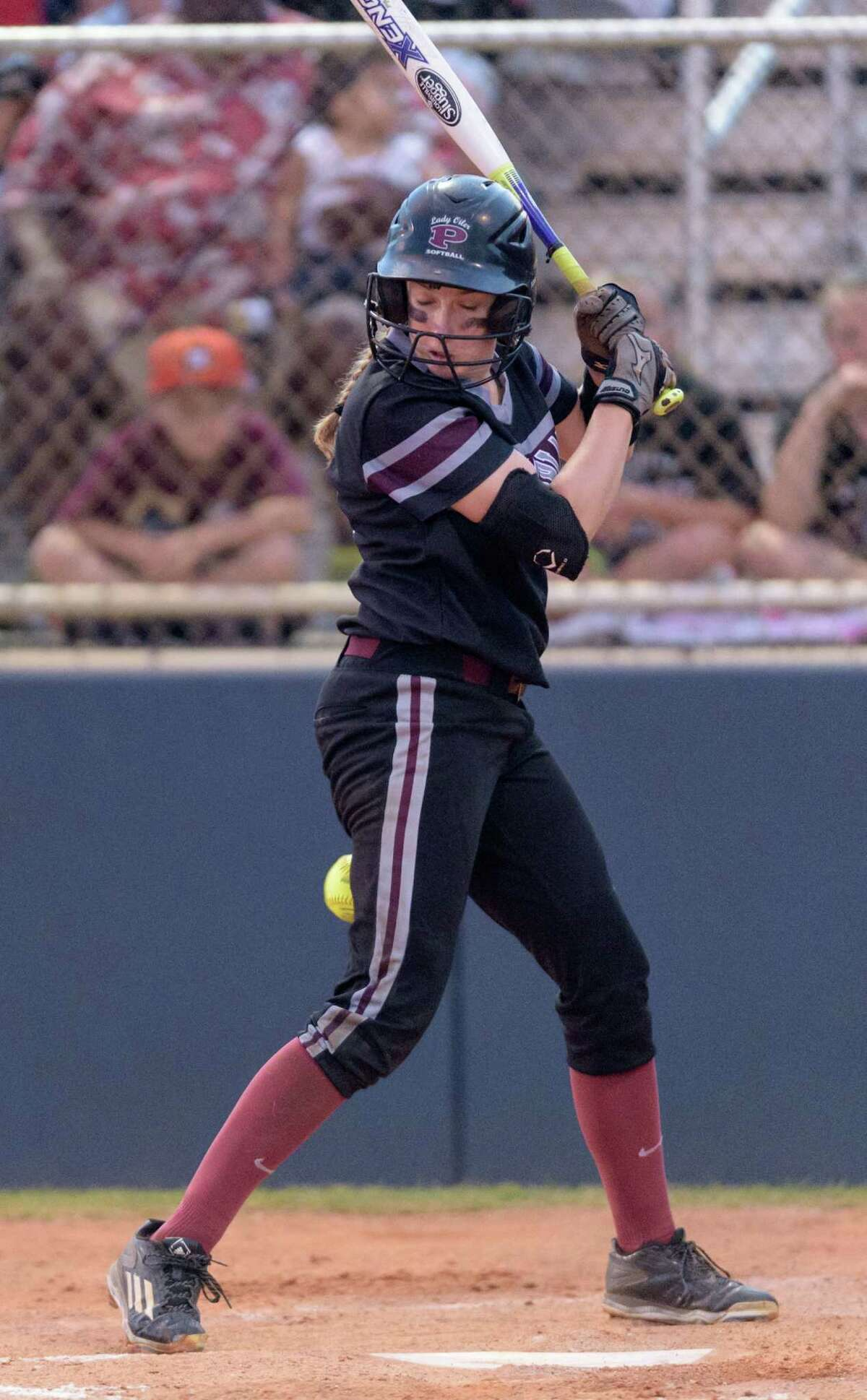 Madison Clements (4) of the Pearland Lady Oilers is hit by a pitch in the second inning against the Deer Park Lady Deer in the Regional Quarterfinals on Friday, May 13, 2016 at the Dawson High School ballpark.