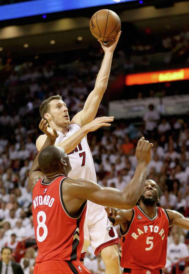 MIAMI, FL - MAY 13:  Goran Dragic #7 of the Miami Heat drives to the basket against teammates Bismack Biyombo #8 and DeMarre Carroll #5 of the Toronto Raptors during Game 6 of the Eastern Conference Semifinals of the 2016 NBA Playoffs at American Airlines Arena on May 13, 2016 in Miami, Florida. NOTE TO USER: User expressly acknowledges and agrees that, by downloading and or using this photograph, User is consenting to the terms and conditions of the Getty Images License Agreement.  (Photo by Streeter Lecka/Getty Images) ORG XMIT: 636230777 Photo: Streeter Lecka / 2016 Getty Images