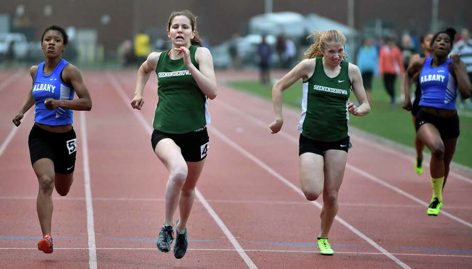 Shen's Alexandra Tudor, second from left, comes in first over Albany's Jahari Coleman, left, in the 200-meter dash during the Shenendehowa Invitational track meet on Friday, May 13, 2016, at Shenendehowa High  in Clifton Park, N.Y. (Cindy Schultz / Times Union) Photo: Cindy Schultz / Albany Times Union