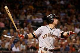 PHOENIX, AZ - MAY 13:  Joe Panik #12 of the San Francisco Giants hits a three-run home run against the Arizona Diamondbacks during the sixth inning of the MLB game at Chase Field on May 13, 2016 in Phoenix, Arizona.  (Photo by Christian Petersen/Getty Images)