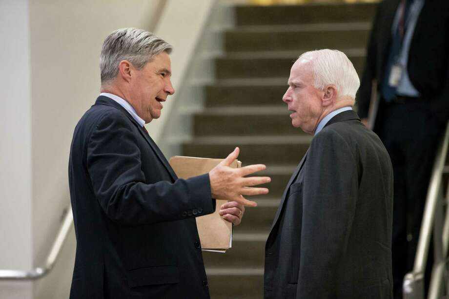 Sen. Sheldon Whitehouse, D-R.I., left, speaks with Senate Armed Services Committee Chairman Sen. John McCain, R-Ariz., on Capitol Hill in Washington, Thursday, May 12, 2016,  as the Senate winds up its week  The Armed Services panel is moving to complete work on the military's budget, the National Defense Authorization Act. (AP Photo/J. Scott Applewhite) ORG XMIT: DCSA109 Photo: J. Scott Applewhite / AP