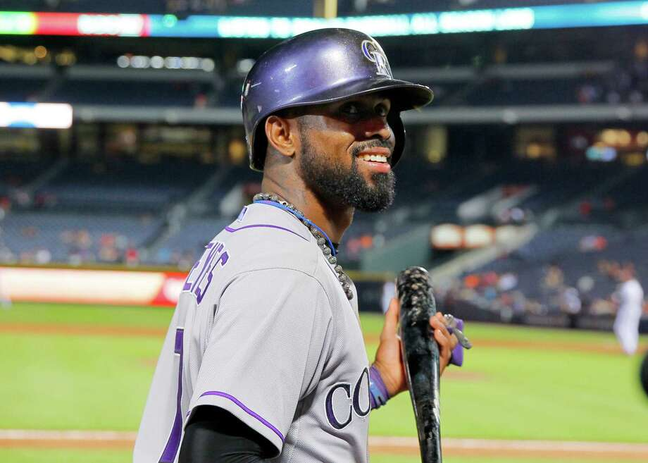 ATLANTA, GA - AUGUST 26: Jose Reyes #7 of the Colorado Rockies walks on deck in the ninth inning against the Atlanta Braves on August 26, 2015 at Turner Field in Atlanta, Georgia. The Rockies won the game 6-3. (Photo by Todd Kirkland/Getty Images) ORG XMIT: 538592563 Photo: Todd Kirkland / 2015 Getty Images