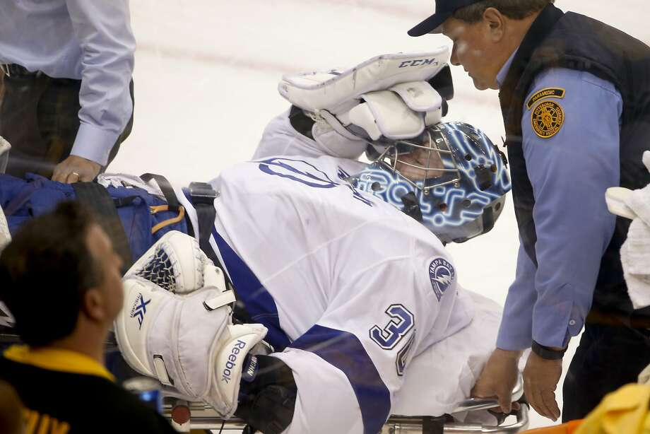 Tampa Baygoalie Ben Bishop is carted off the ice after hurting his left leg in Game 1 of the Eastern Conference finals. Photo: Gene J. Puskar, Associated Press