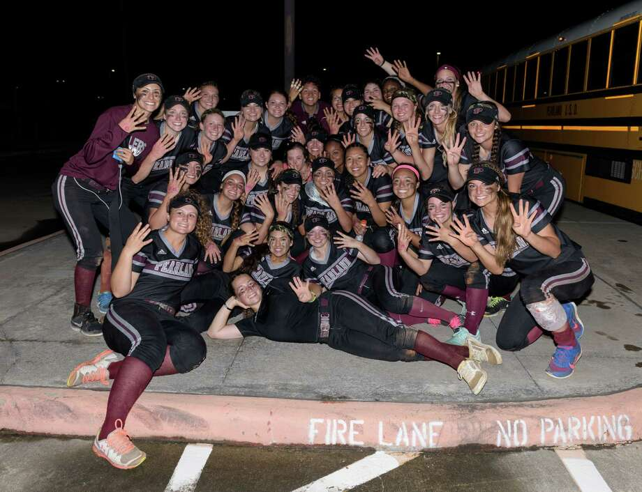 The Pearland Lady Oilers pose for a photo after defeating the Deer Park Lady Deer two out of three games to win the Regional Quarterfinals on Friday, May 13, 2016 at the Dawson High School ballpark. Photo: Wilf Thorne, For The Chronicle / © 2016 Houston Chronicle