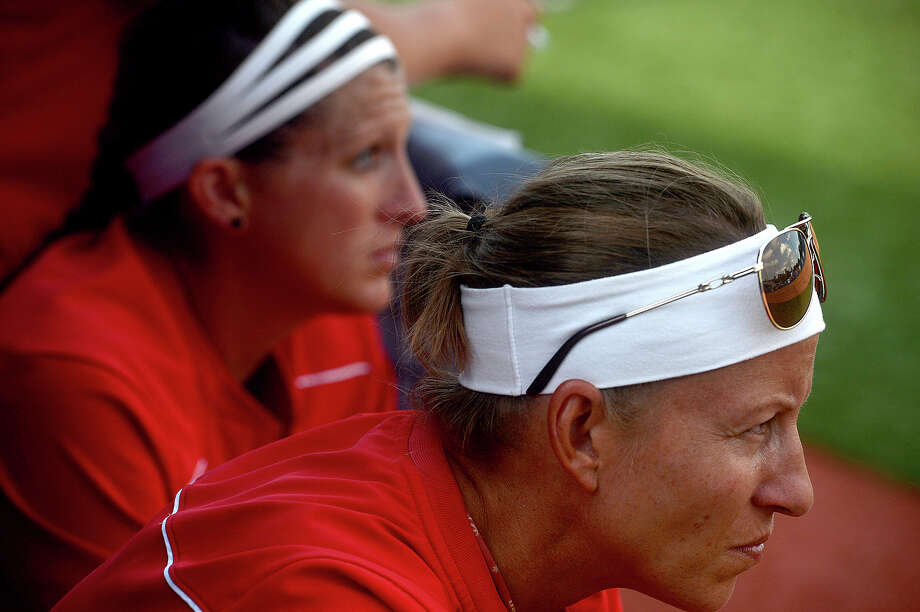 Lamar's head coach Holly Bruder and assistant Allison Honkofsky take in the game action from the dugout as they face McNeese State in the championship round of the Southland Conference tournament Friday. The Lady Cardinals took runner-up after falling to the Cowgirls 5-2. Photo taken Friday, May 13, 2016 Kim Brent/The Enterprise Photo: Kim Brent / Beaumont Enterprise