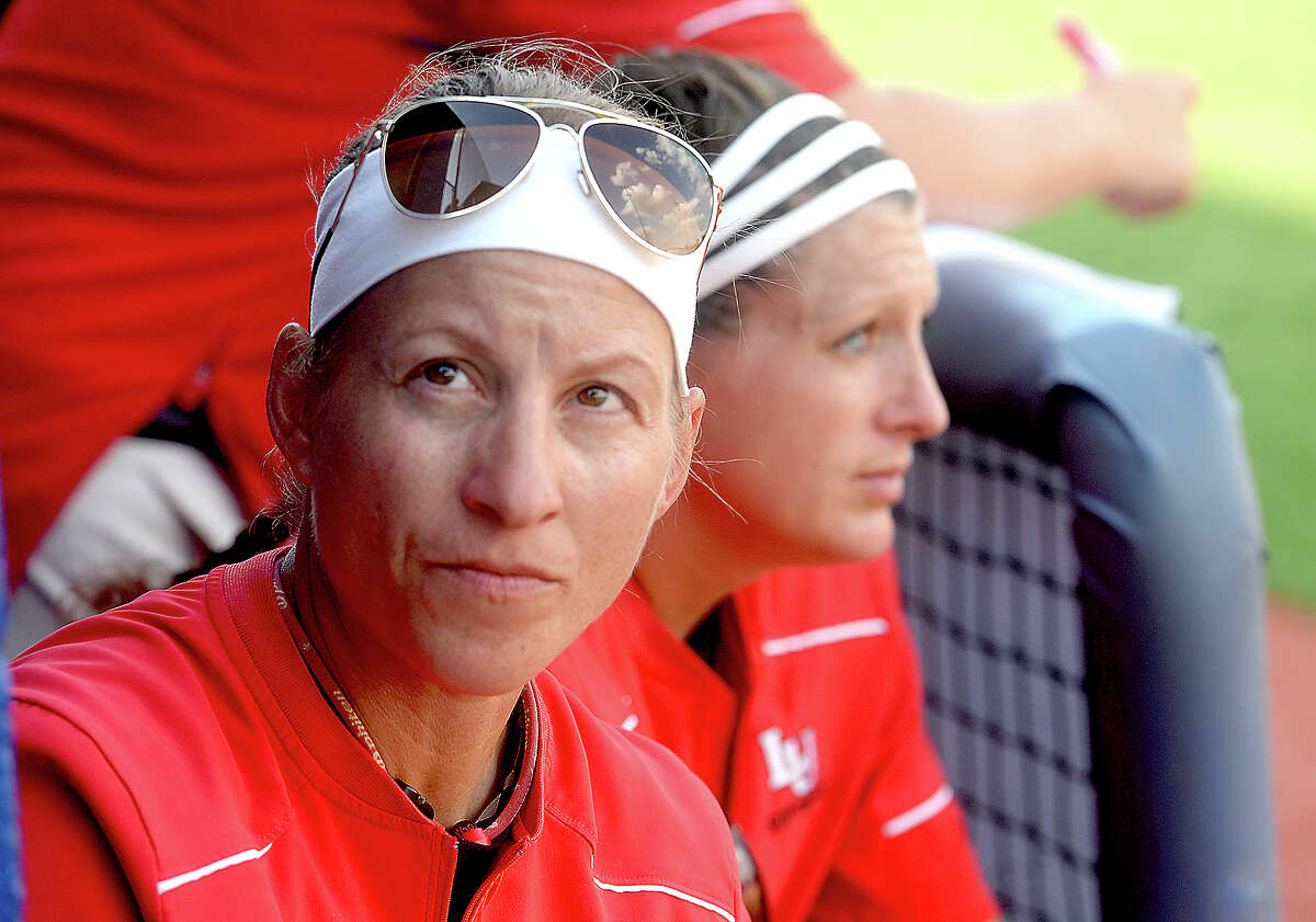 Lamar's head coach Holly Bruder looks toward the stands as she and assistant coach Allison Honkofsky watch the infield from the dugout as they face McNeese State in the championship round of the Southland Conference tournament Friday. The Lady Cardinals took runner-up after falling to the Cowgirls 5-2. Photo taken Friday, May 13, 2016 Kim Brent/The Enterprise