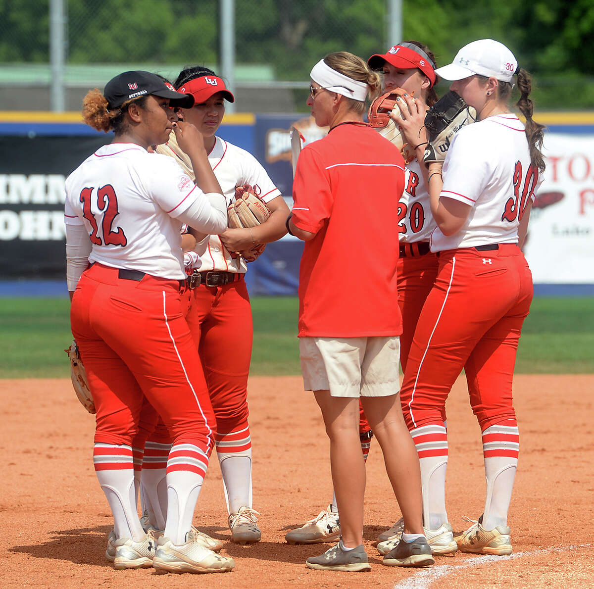 Lamar's coach Holly Bruder huddles with the infield as they face McNeese State in the championship round of the Southland Conference tournament Friday. The Lady Cardinals took runner-up after falling to the Cowgirls 5-2. Photo taken Friday, May 13, 2016 Kim Brent/The Enterprise