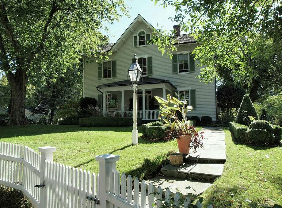 The property at 175 Old Post Road is on the market for $1,275,000. The 3,228-square-foot Colonial was built in 1837. Photo: Contributed Photos / Fairfield Citizen