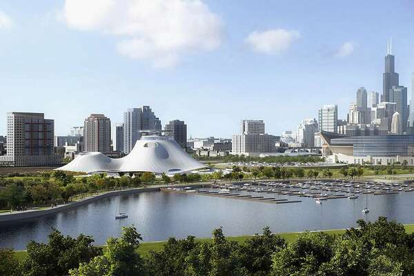 FILE -This file artist rendering released Sept. 17, 2015, by the Lucas Museum of Narrative Art shows the proposed museum, left center, in Chicago. At a status hearing in Chicago, Tuesday, May 10, 2016, a federal judge could decide to let construction begin on the proposed museum. (Lucas Museum of Narrative Art via AP, File)