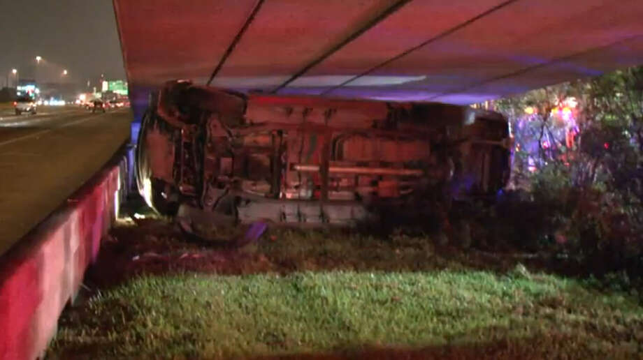 Police found an empty pickup truck lodged under the North Freeway early Saturday morning. Photo: Metro Video