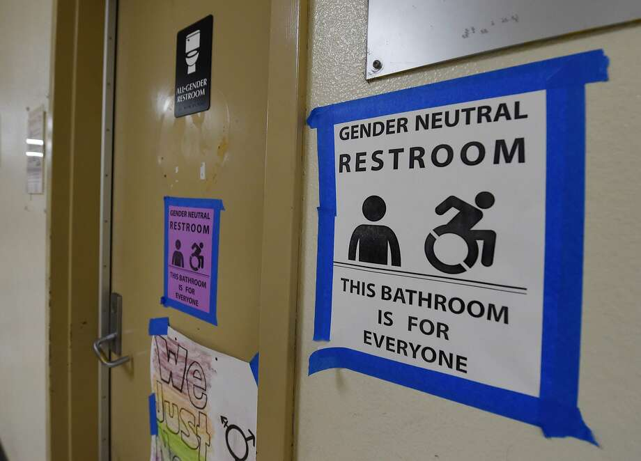 Signs are posted outside the Santee High School's gender-neutral restrooms at its campus in Los Angeles, in conformance with California law. Photo: MARK RALSTON, AFP/Getty Images