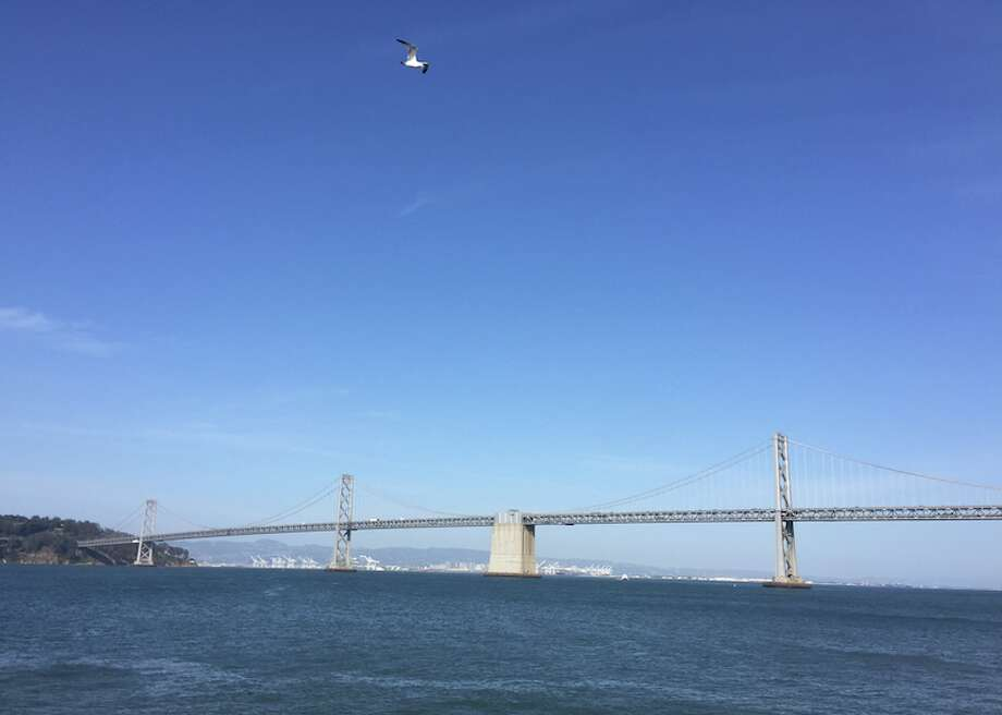 The Bay Bridge is seen on Friday, May 13, 2016. Bay Area temperatures are expected to reach 90 degrees in some areas this weekend. Photo: Jessica Mullins, SFGATE