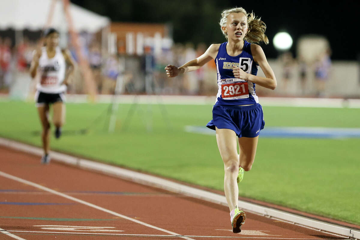 Alamo Heights' Abby Gray looks to tie the stadium scoreboard as she crosses the finish line of the 5A girls 1,600-meter run during the second day of the UIL state track and field championships at Myers Stadium in Austin on May 13, 2016. Gray defended her state title in the event with a time of 4 minutes, 54.66 seconds.
