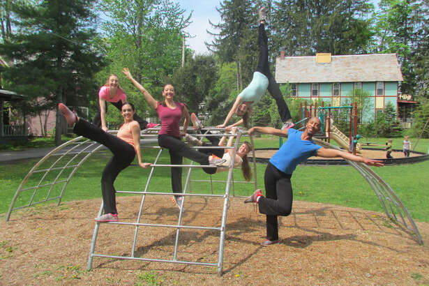 """Ellen Sinopoli Dance Company performs """"Undercover Playground"""" at a playground in Round Lake, NY, on Saturday, May 14, 2016. Children in the audience were invited to participate in the performance."""