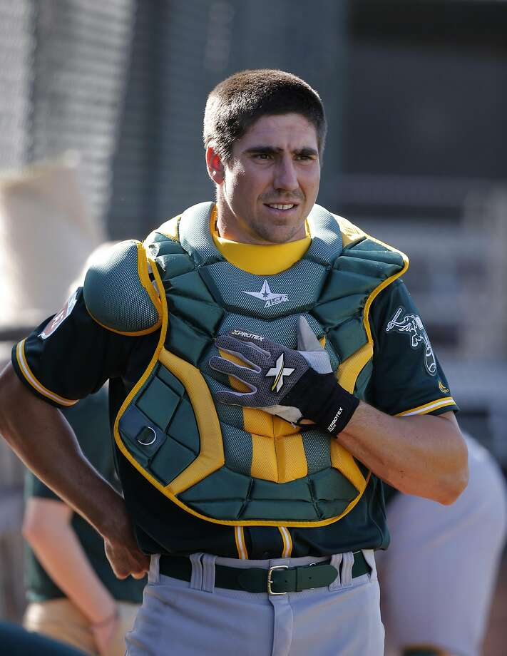 Matt McBride, 29 gears up to catch during Oakland Athletics spring training workouts at the Lew Wolff Training Complex in Mesa, Arizona on  Saturday February 27, 2016. Photo: Michael Macor, The Chronicle
