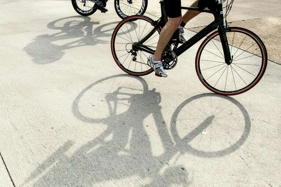 Cyclist cast their shadows on the race course during the Memorial Hermann Ironman North American Championship Texas triathon on Saturday, May 14, 2016, in The Woodlands. Photo: Brett Coomer, Houston Chronicle / © 2016 Houston Chronicle