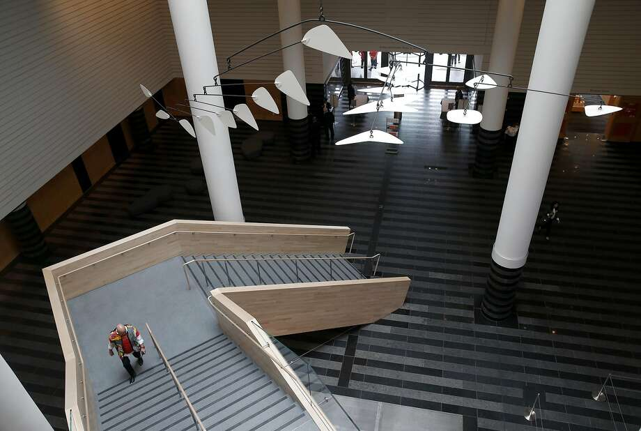 A visitor climbs a staircase in what was the old main lobby and entrance at the reopening of SFMOMA in San Francisco, Calif. on Saturday, May 14, 2016. The museum opened its doors to the public following a three-year expansion project which nearly triples the gallery space. Photo: Paul Chinn, The Chronicle