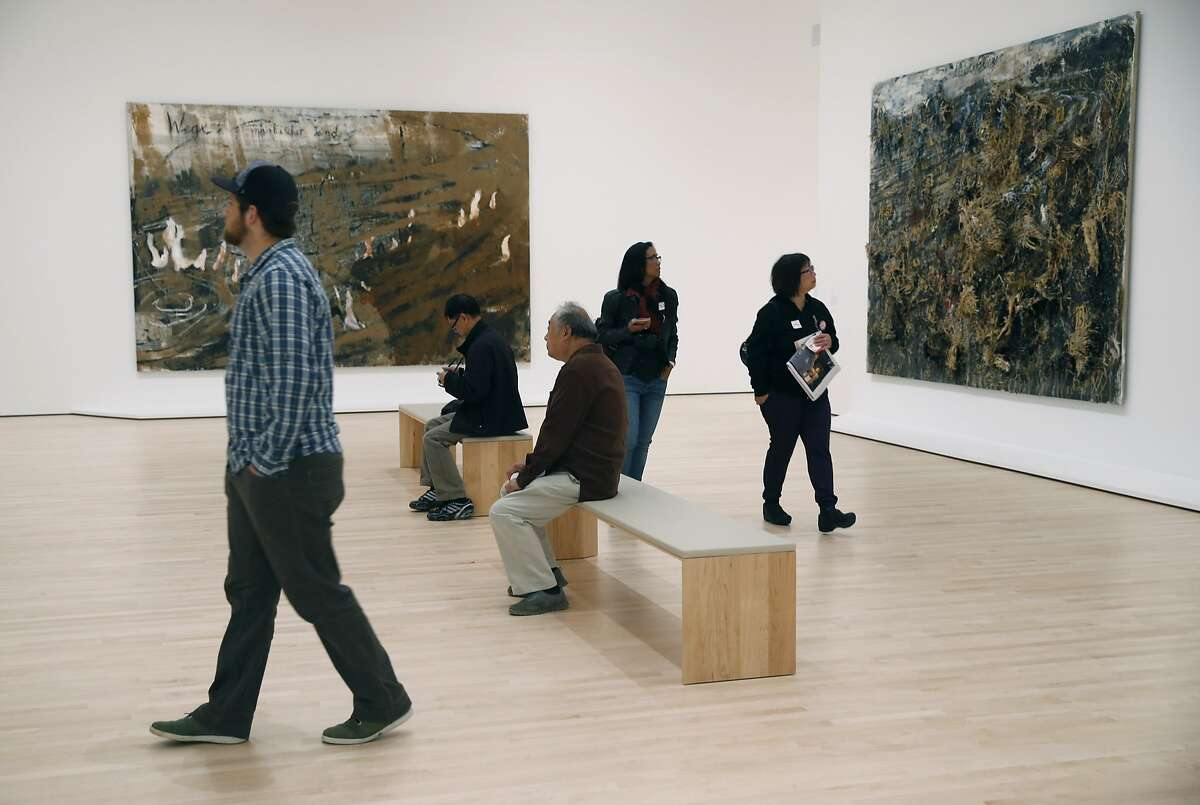 Visitors walk through one of the many new galleries at the expanded SFMOMA in San Francisco, Calif. on Saturday, May 14, 2016. The museum opened its doors to the public following a three-year expansion project which nearly triples the gallery space.