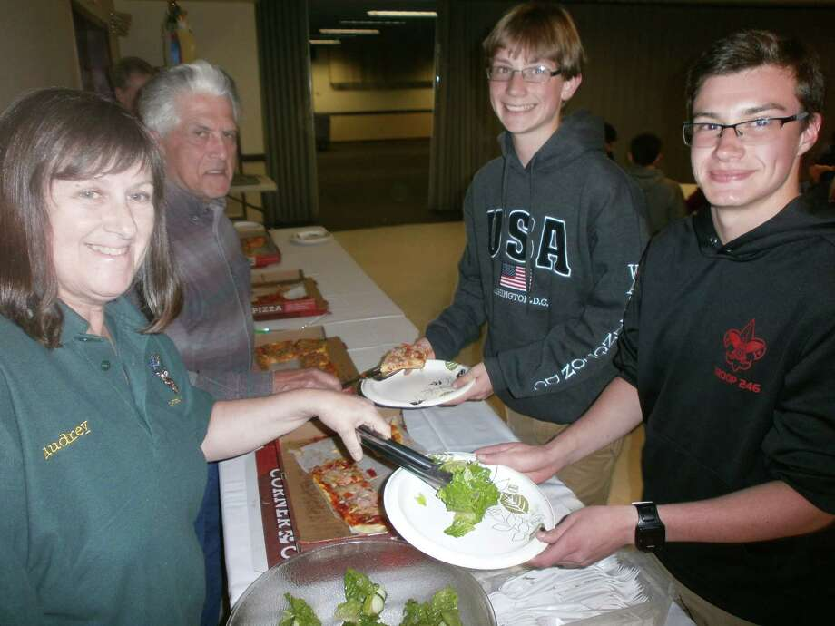 Elks Lodges across the U.S. designated the first week in May as Youth Appreciation Week to honor America's junior citizens for their accomplishments and to recognize their services to the community. As part of the celebration, the Clifton Park Elks hosted Boy Scout Troop 246 for a pizza dinner on Monday, May 2. Pictured below serving dinner to the Scouts are, from left, Elks Audrey Osterlitz, Exalted Ruler and Denis Ryder with Scouts Mike Lilholt and Alex Bianconi. (Daniel Mathias)