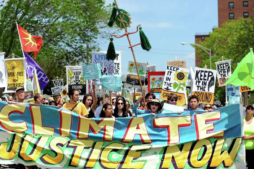 Environmental activists from around the region march down Pearl Street to the Port of Albany on Saturday, May 14, 2016, in Albany, N.Y. The demonstration delayed oil train traffic at the Port of Albany to raise awareness for the region's opposition to all fossil fuels. The event was part of a weeklong global effort called Break Free From Fossil Fuels. (Cindy Schultz / Times Union)