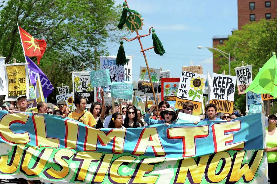 Environmental activists from around the region march down Pearl Street to the Port of Albany on Saturday, May 14, 2016, in Albany, N.Y. The demonstration delayed oil train traffic at the Port of Albany to raise awareness for the region's opposition to all fossil fuels. The event was part of a weeklong global effort called Break Free From Fossil Fuels. (Cindy Schultz / Times Union) Photo: Cindy Schultz / Albany Times Union