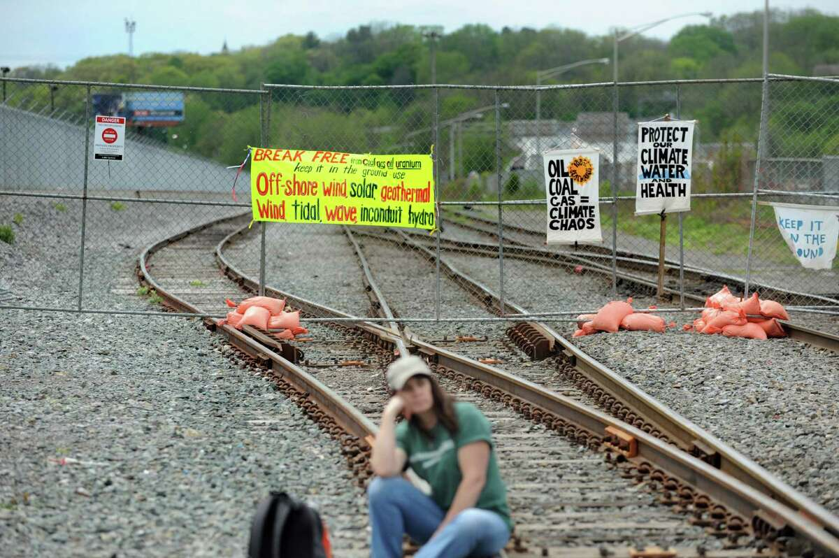 Signs hang on the chainlink fence that kept environmental activists away from the trains on Saturday, May 14, 2016, at the Port of Albany in Albany, N.Y. The demonstration delayed oil train traffic at the Port of Albany to raise awareness for the region's opposition to all fossil fuels. The event was part of a weeklong global effort called Break Free From Fossil Fuels. (Cindy Schultz / Times Union)
