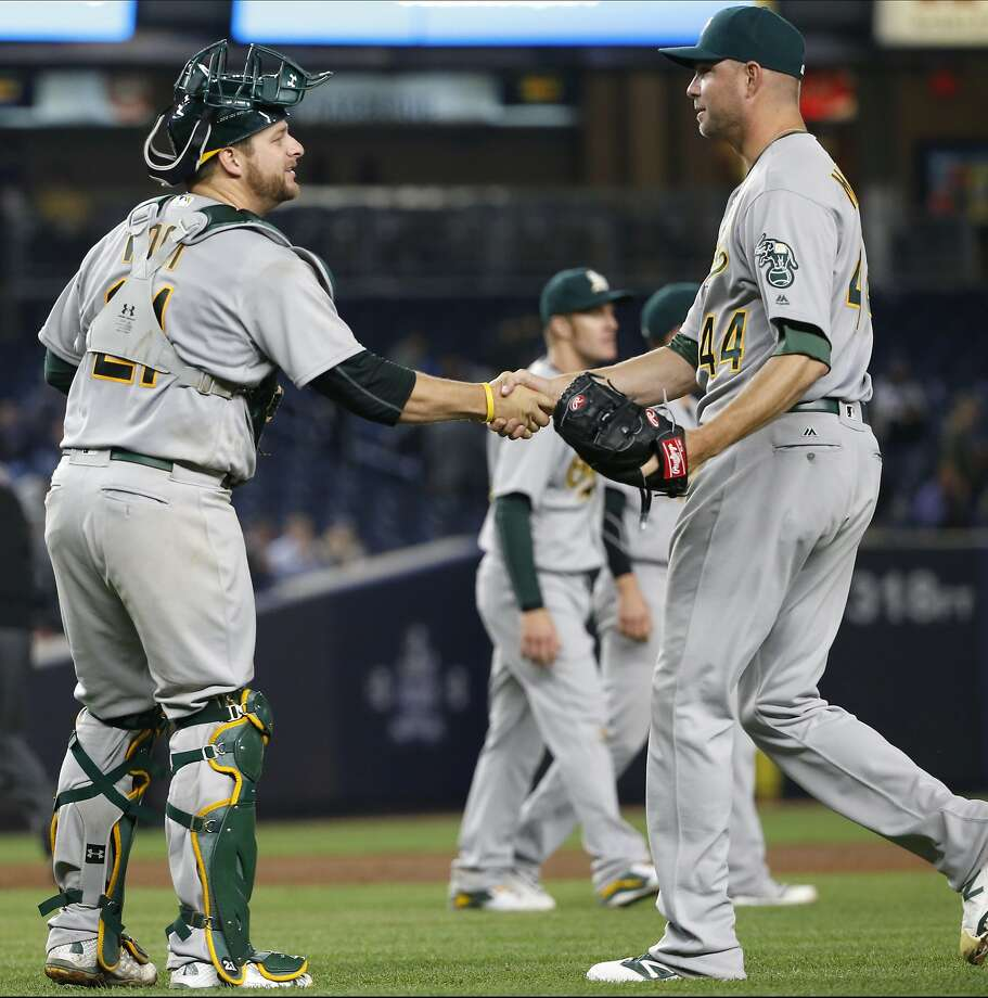 Oakland Athletics catcher Stephen Vogt, left, congratulates relief pitcher Ryan Madson (44) after the Athletics' 7-3 victory over the New York Yankees in a baseball game in New York, Thursday, April 21, 2016. (AP Photo/Kathy Willens) Photo: Kathy Willens, Associated Press