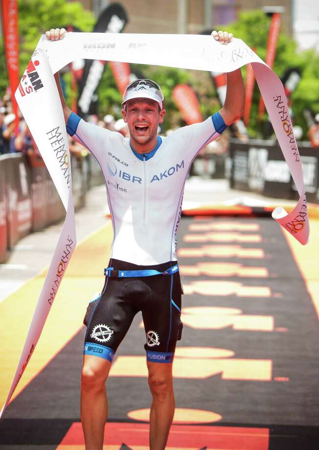 Patrick Lange, of Germany, crosses the finish line to win the Memorial Hermann Ironman North American Championship Texas triathon on Saturday, May 14, 2016, in The Woodlands. Photo: Brett Coomer, Houston Chronicle / © 2016 Houston Chronicle