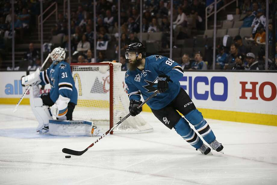 Brent Burns is among the top offensive threats among NHL defensemen. But at 6-foot-5, he can also throw his weight around. Photo: Tony Avelar, Associated Press