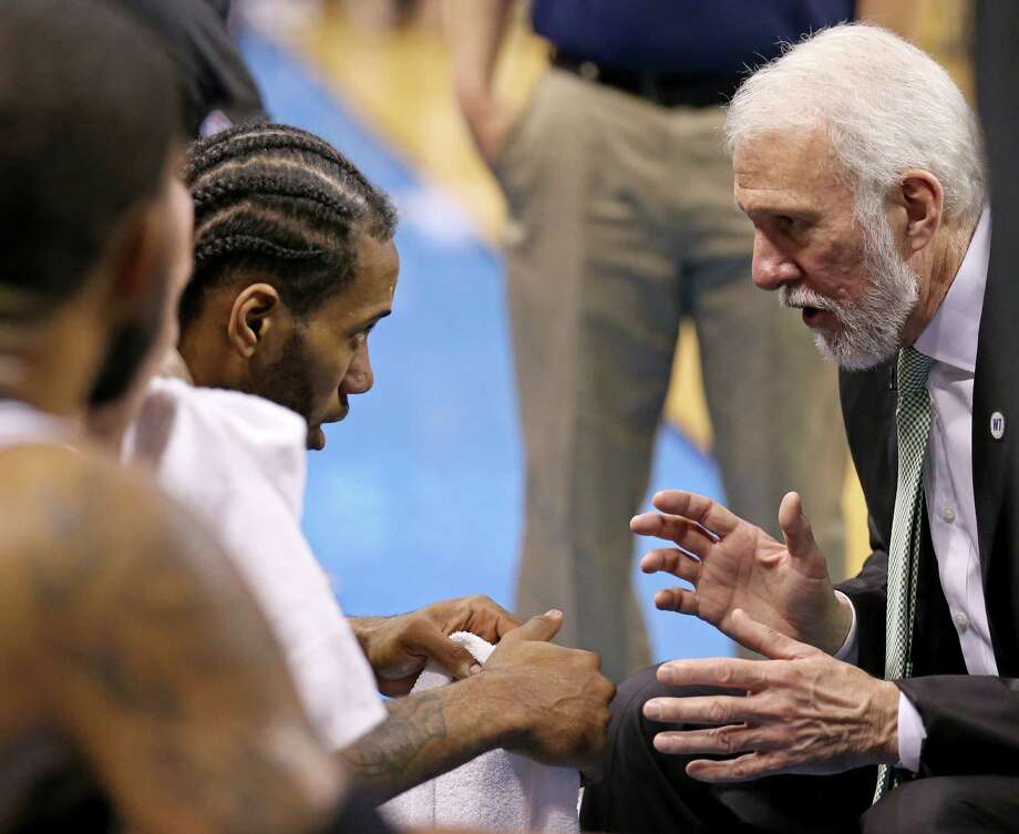 LEFT: San Antonio Spurs' Kawhi Leonard talks with head coach Gregg Popovich on the bench during second half action of Game 6 in the Western Conference semifinals against the Oklahoma City Thunder Thursday May 12, 2016 at Chesapeake Energy Arena in Oklahoma City, Oklahoma. The Thunder won 113-99. Photo: Edward A. Ornelas / San Antonio Express-News / © 2016 San Antonio Express-News